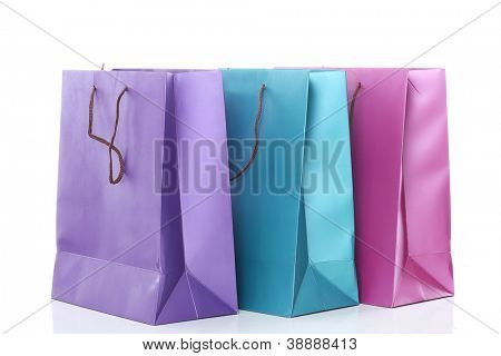 Close up of colored shopping bags isolated on a white background