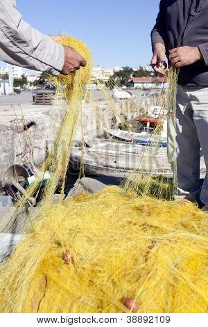 Fishermen Casting Nets