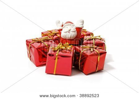 Santa Claus and gifts isolated on white background.