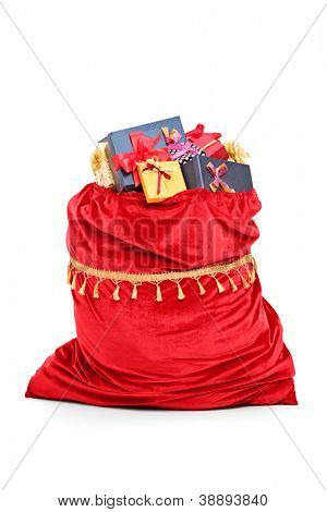 Santa�¢??s bag full of Christmas presents isolated against white background