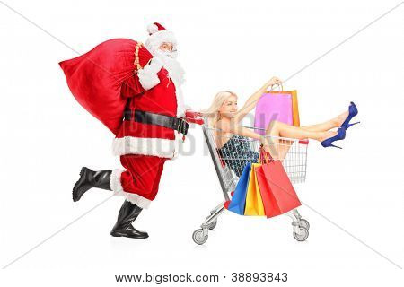 Santa Claus pushing a young woman in a shopping cart isolated on white background