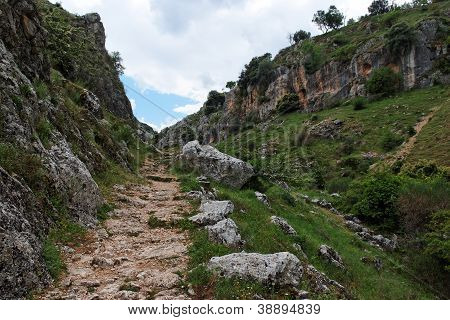 Trail in gorge Mirador de Bailon near Zuheros in Spain on cloudy day