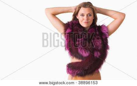 Woman holding her head while wearing pink stole