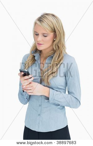 Blonde woman texting on her smartphone