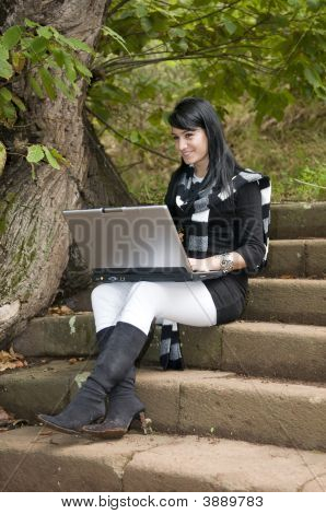 Woman Working With Portatil Laptop In The Forest