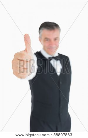 Man posing in suit with thumbs up