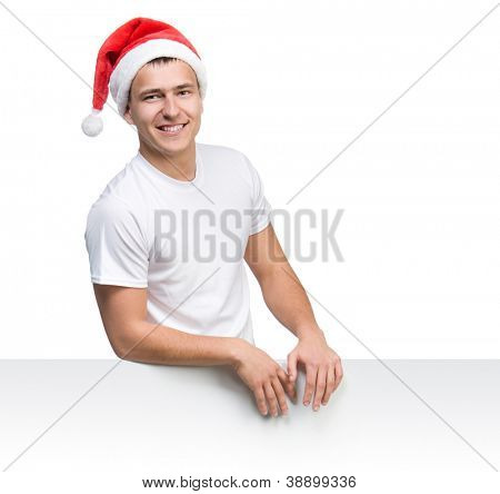 young man in a Santa Claus hat behind the white board