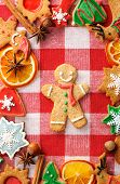 Christmas gingerbread man cookie over tablecloth