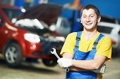 stock photo of assemblage  - Young repairman auto mechanic inspecting car during automobile maintenance at engine auto repair shop service station - JPG
