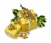 stock photo of christmas-present  - Christmas gift boxes with ribbon and holly isolated on white - JPG