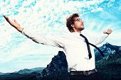 foto of spectacles  - Successful business man standing on a peak of the mountain and purposefully looking away - JPG