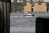 NEW YORK - NOV 1: An NYPD boat patrols the Hudson on November 1, 2012 in New York CIty. The NYPD has