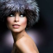 Fur Fashion Hat. Beautiful Girl in Furry Hat. Winter Woman Portrait