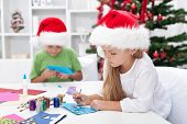 pic of card-making  - Kids making christmas or seasonal greeting cards - JPG