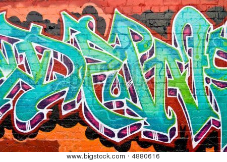 Graffiti:colorful Detail On The Textured Brick Wall