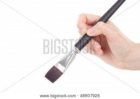 Caucasian Hand With Bright Shaped Brush