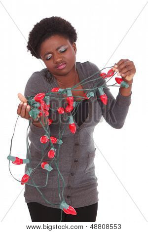 Woman with tangled Christmas lights