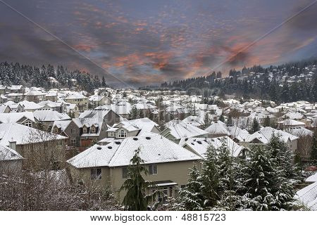 Winter Scene In Suburbs Neighborhhood With Sunset Sky