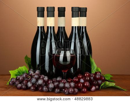 Wine bottles on brown background