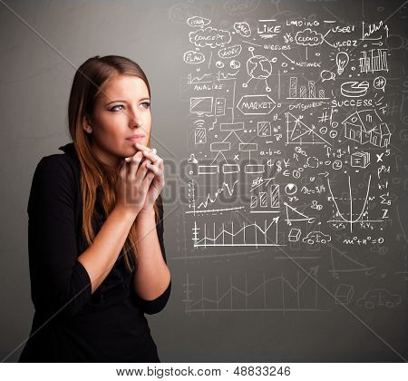 Pretty young woman looking at stock market graphs and symbols