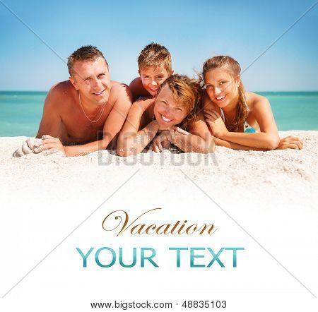 Happy Family Having Fun at the Beach. Joyful Family. Vacation and Travel concept. Summer Holidays. Parents with Children enjoying a holiday at the sea