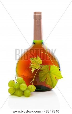 Wine Bottle With Wine Grapes And Grape Leaves.