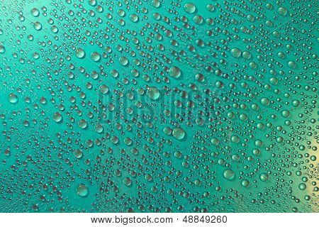Water Droplets On A Greenish Background
