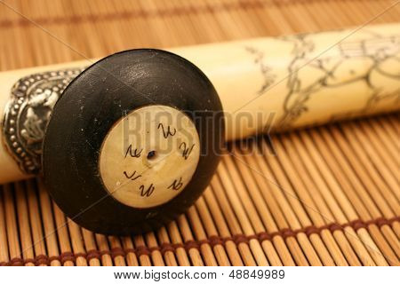 Opium Pipe On A Bamboo Mat