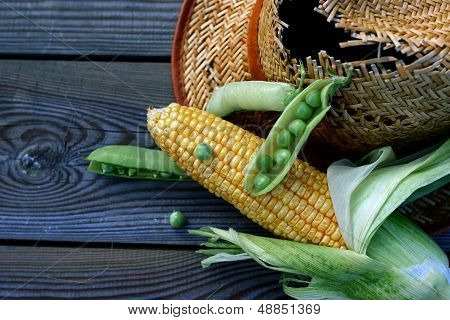 corn cob and pod peas.
