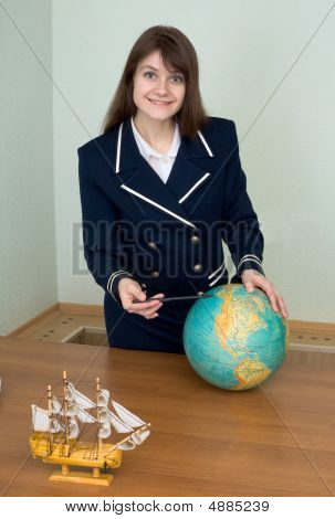 Girl In Uniform At A Table With Globe