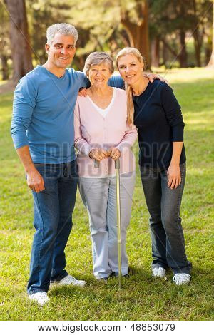 portrait of middle aged couple and mother outdoors