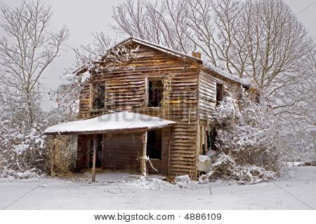 Snow Covered Abandoned House