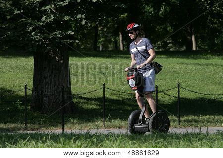 WASHINGTON, DC - JULY 29: A tourist operates a Segway during a Segway tour along the National Mall on July 29, 2013 in Washington.