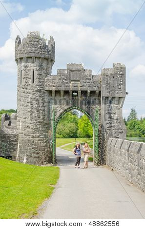 Ashford Castle, Ireland - young tourists visiting gate
