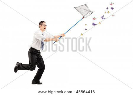Full length portrait of a man catching butterflies with net isolated on white background