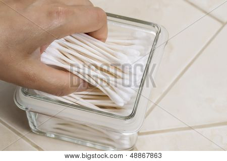 Adding More Cotton Swabs Into Glass Container