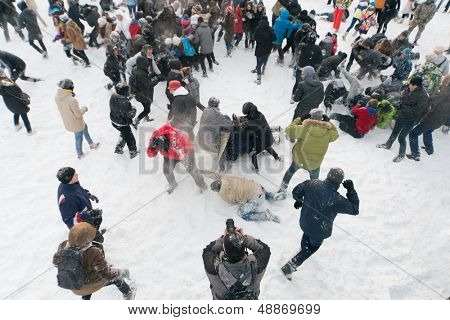 MOSCOW - DEC 9: A lot of people are having fun throwing snow at each other in Central Park of Culture and Rest named after Maxim Gorky December 9, 2012, Moscow, Russia. Park was established in 1928.