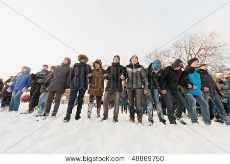 MOSCOW - DEC 9: Several people standing in a row in the Central Park of Culture and Rest named after Maxim Gorky December 9, 2012 in Moscow, Russia. The park was established in 1928.