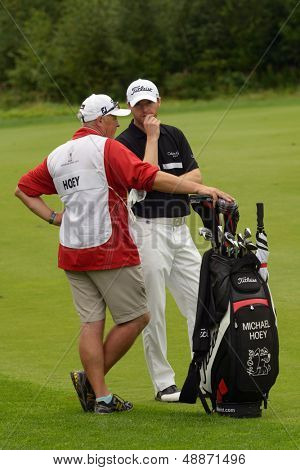 MOSCOW, RUSSIA - JULY 28: Michael Hoey of Northern Ireland and his caddie during final round of the M2M Russian Open at Tseleevo Golf & Polo Club in Moscow, Russia on July 28, 2013