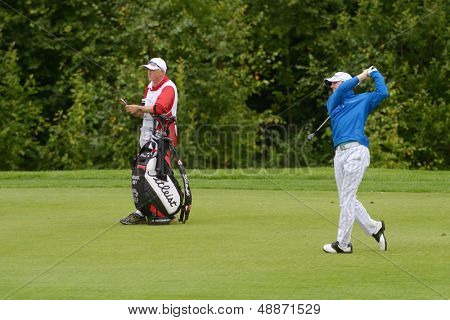 MOSCOW, RUSSIA - JULY 27: Michael Hoey of Northern Ireland and his caddie during 3rd round of the M2M Russian Open at Tseleevo Golf & Polo Club in Moscow, Russia on July 27, 2013