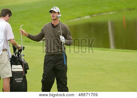 MOSCOW, RUSSIA - JULY 27: Alexandre Kaleka of France with his caddie during 3rd round of the M2M Russian Open at Tseleevo Golf & Polo Club in Moscow, Russia on July 27, 2013