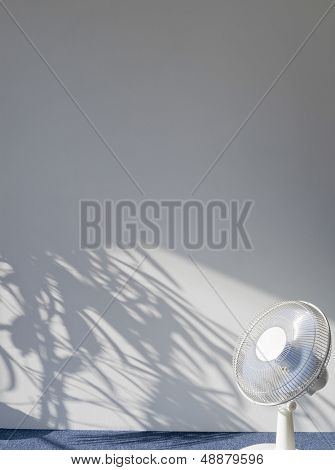 View of an electric fan in empty room