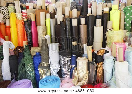 Closeup of various fabric bolts in store
