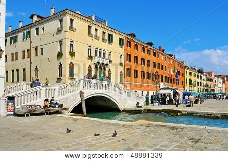 VENICE, ITALY - APRIL 12: Ponte del Sepolcro in Riva Schiavoni on April 12, 2013 in Venice, Italy. Riva Schiavoni, in the riverside of the Venetian Lagoon, is one of the busiest places by tourists