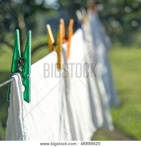 White Laundry Drying On A Clothesline
