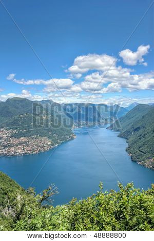 Alpine View Of Mountains At Lake Lugano
