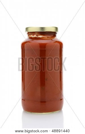 Closeup of a jar of spaghetti sauce isolated with reflection.