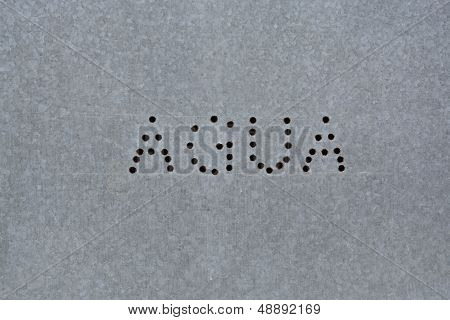 Spanish text agua on zink board
