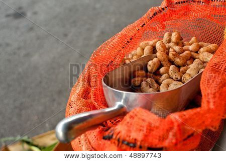 Scooper Full Of Peanuts Sits In Bag At Farmers Market