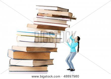 Student woman afraid of pile of books. Isolated on white background. Learning problem and exam concept.